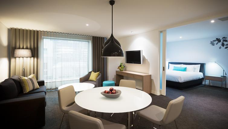 Living/dining area at The Como Melbourne Apartments