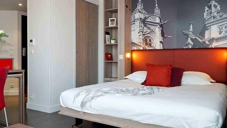 Warm bedroom in Adagio Caen Centre