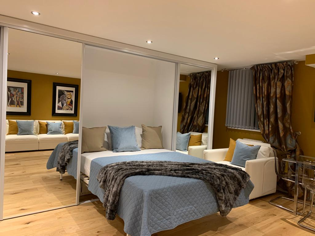 Bed at Millharbour Apartment, Canary Wharf, London