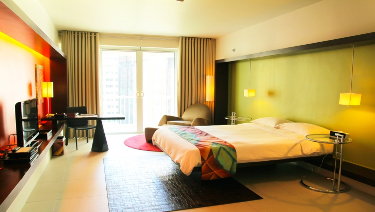 Vibrant bedroom at The Picasso Boutique Residences