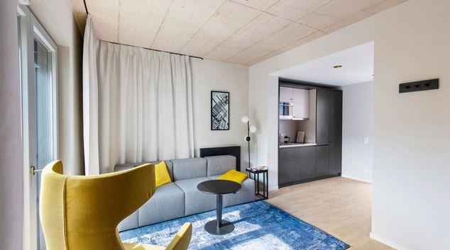 Open plan living area at Joyn Dusseldorf Apartments, Altstadt, Dusseldorf