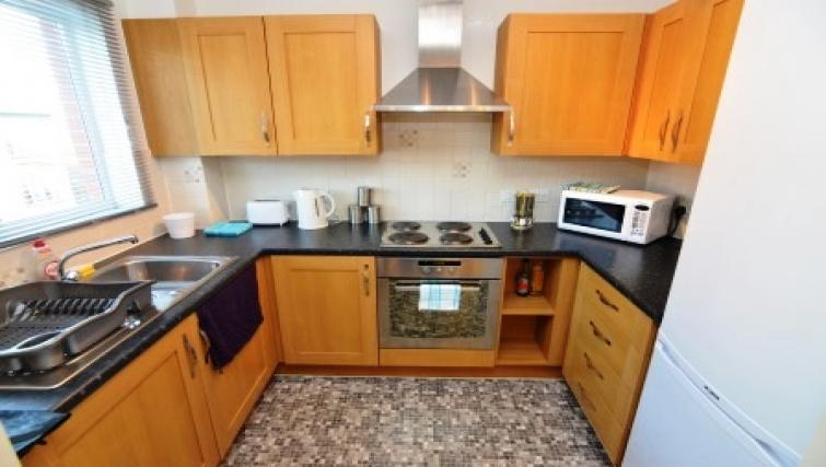 Equipped kitchen at Coventry Apartments