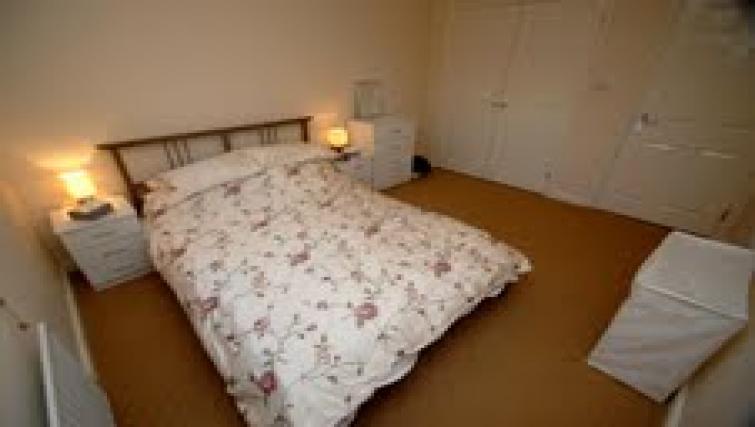 Spacious bedroom at  Longfellow Apartment