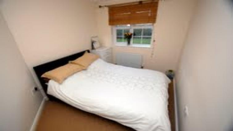 Bed at Longfellow Apartment