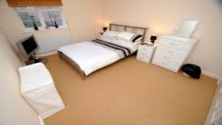 Large bedroom at  Longfellow Apartment