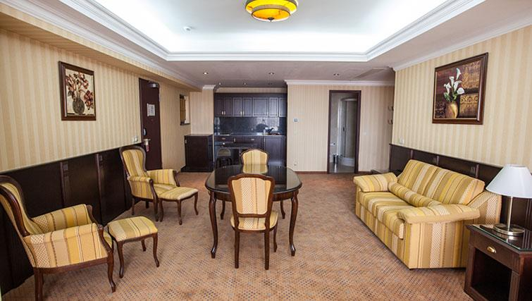 Open-plan living area at Ramada Suites Bucharest North