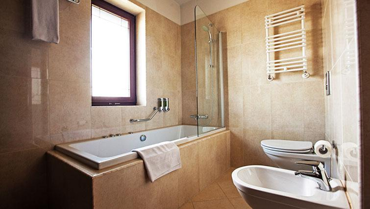 Shower over bath at Ramada Suites Bucharest North