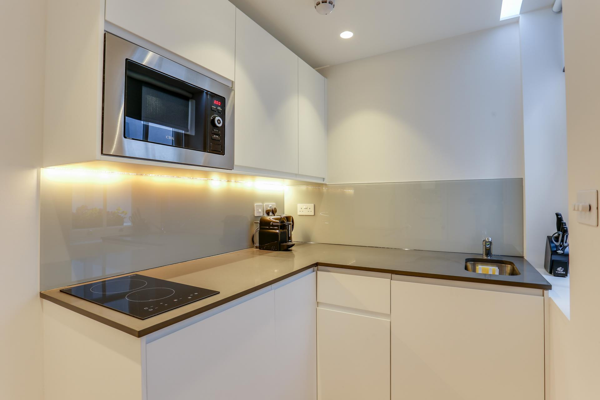 Sleek kitchen at Inverness Terrace Apartments, Bayswater, London