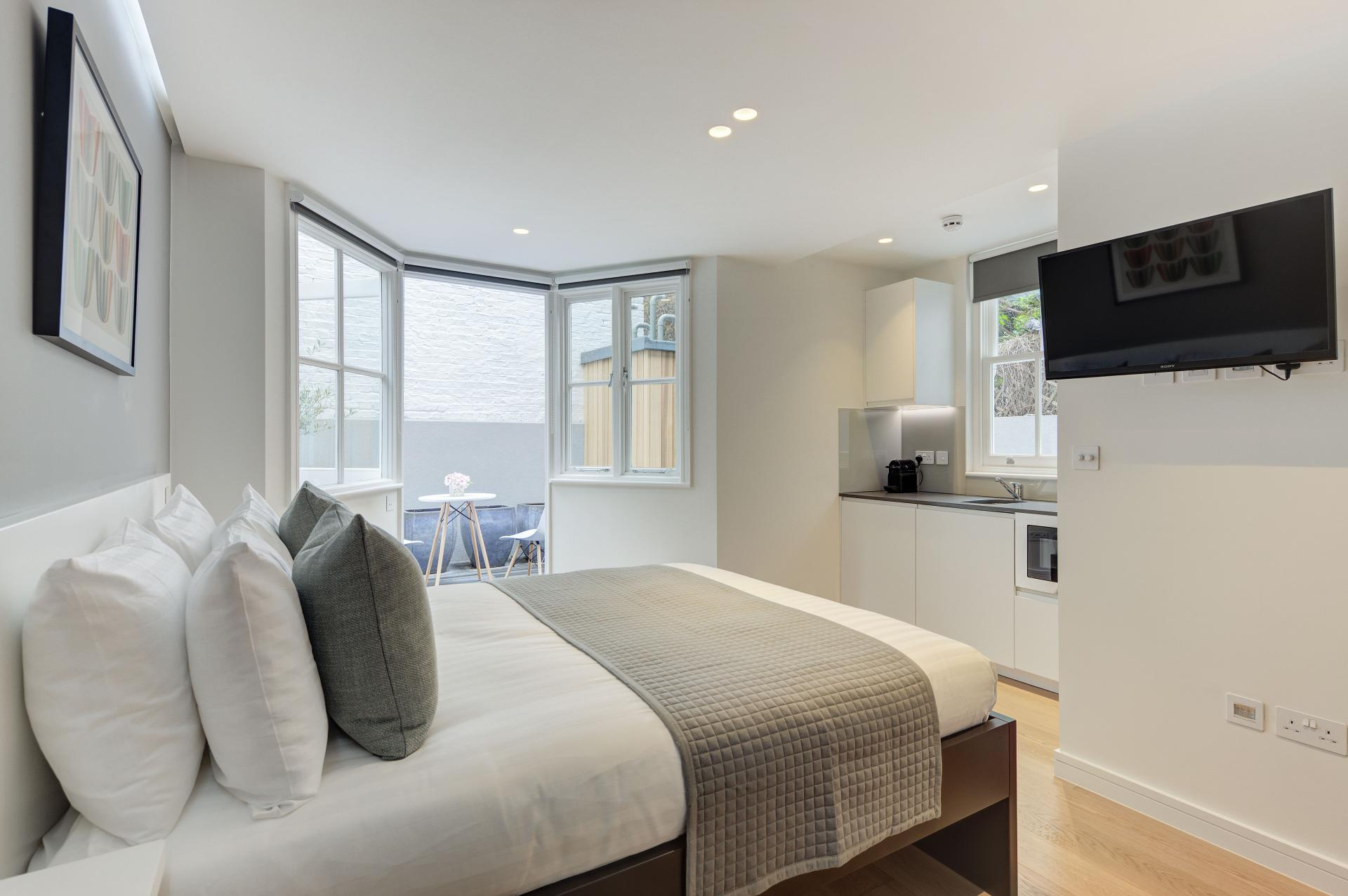 Bright bedroom at Inverness Terrace Apartments, Bayswater, London