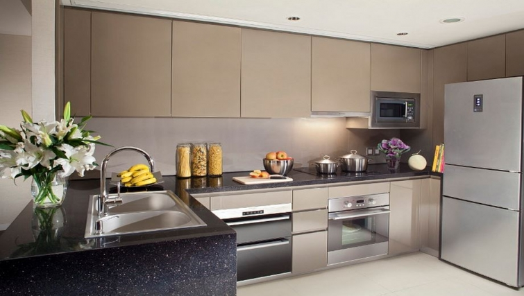 Well equipped kitchen in Ascott Huai Hai Road Apartments
