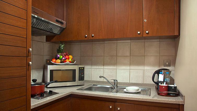 Classic kitchen in Al Rawda Arjaan Apartments