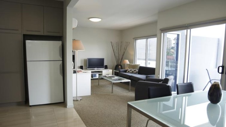 Well equipped open plan living area at Quest Brisbane Spring Hill