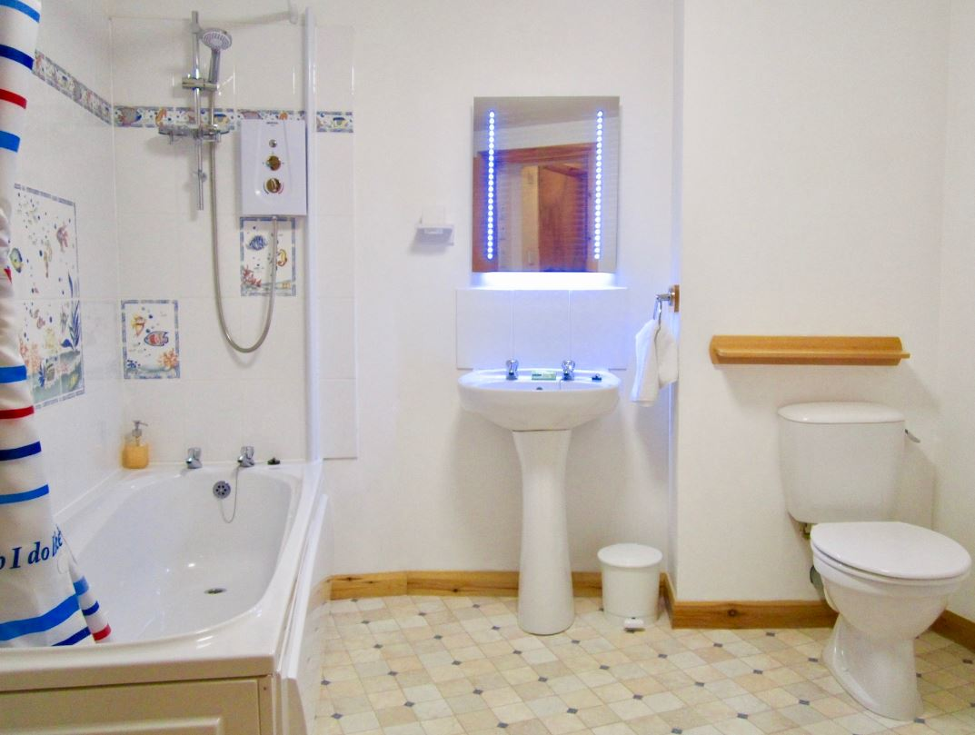 Large bathroom at Dolphin Bay Suites