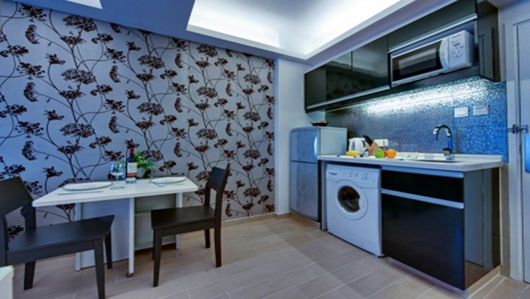Well equipped kitchen in The Bauhinia Apartments