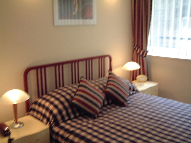 Cosy bedroom at King Regents Place Apartments