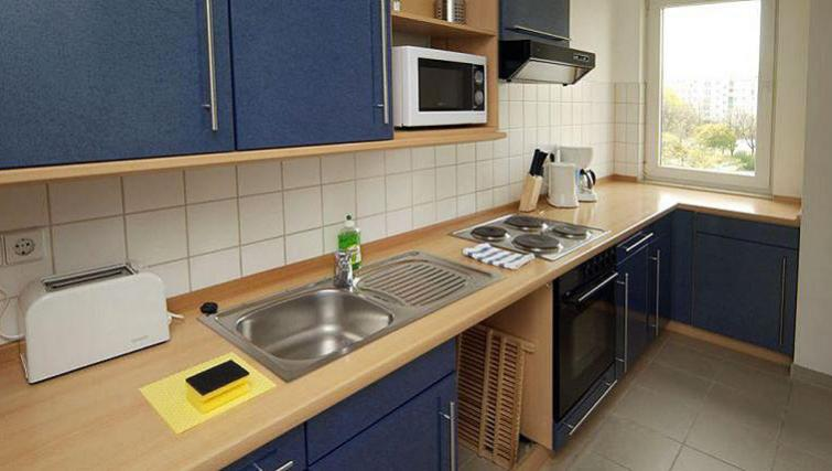 Fully equipped kitchen at Gartenstrasse Apartments