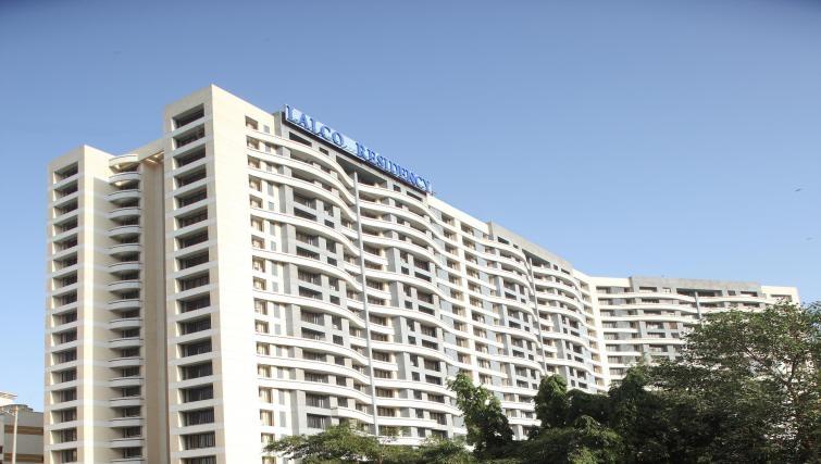 Stately exterior to Kalpaturu Apartments