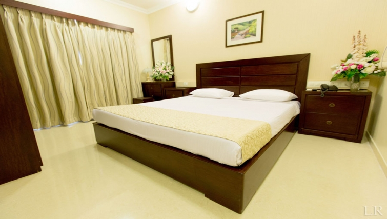 Spacious bedroom in Kalpaturu Apartments