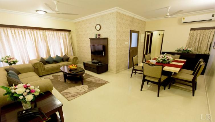 Open-plan living area in Kalpaturu Apartments