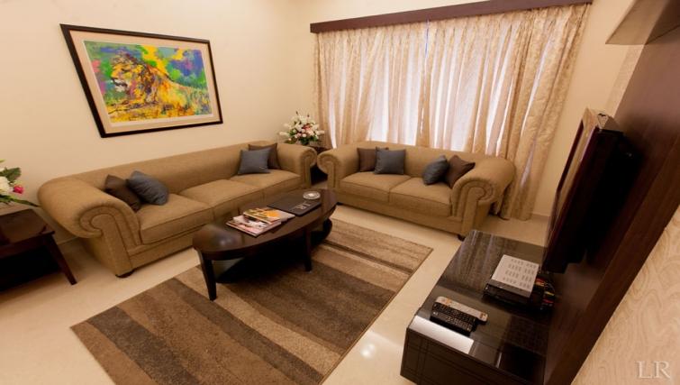 Modern living area in Kalpaturu Apartments