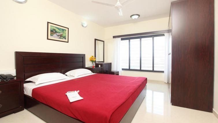 Elegant bedroom in Kalpaturu Apartments