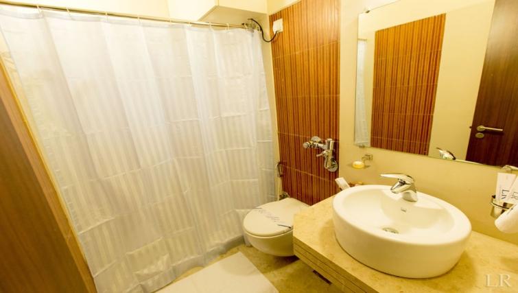 Stylish bathroom in Kalpaturu Apartments