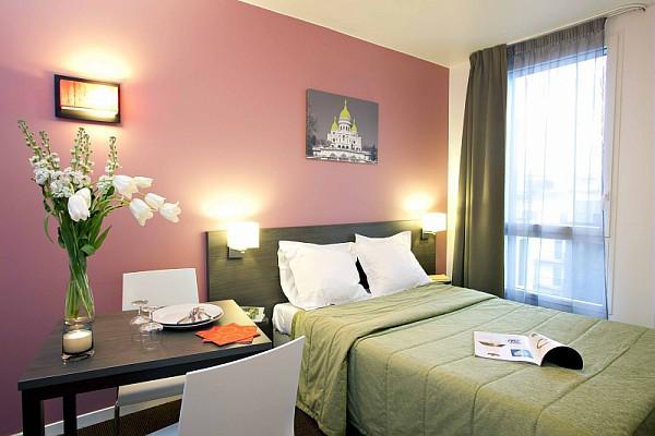 Modern bedroom at Adagio Access Paris Asnieres