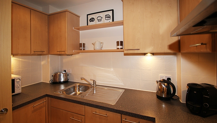Equipped kitchen at Centrium Apartments