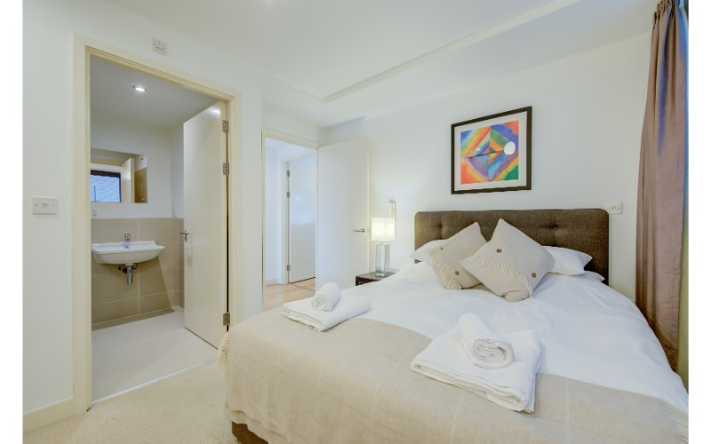 Comfortable bed at Finzels Reach Apartments