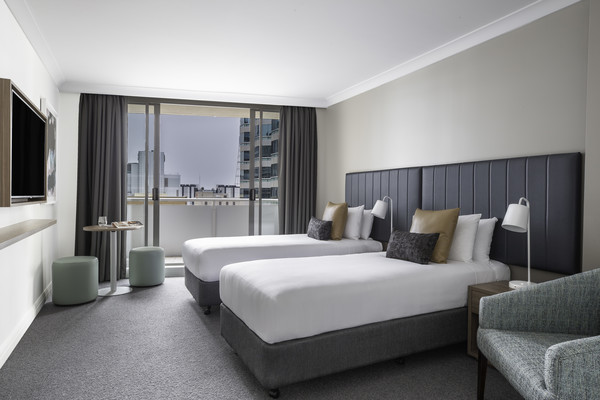 Twin beds at Mantra Chatswood, North Ryde, Sydney