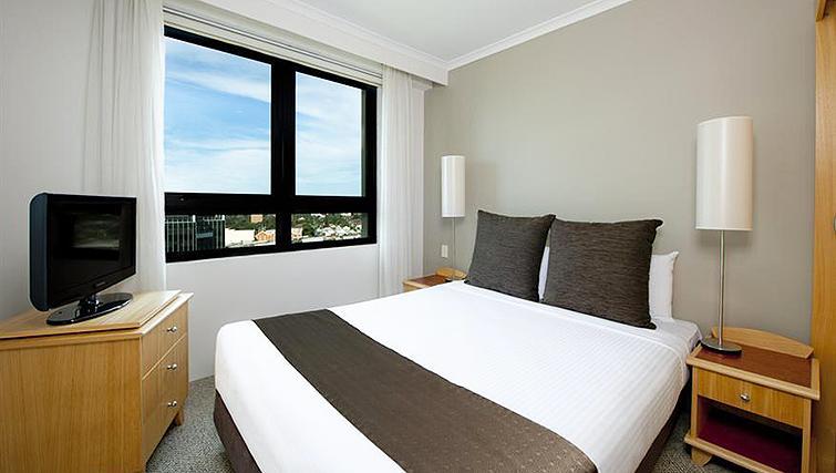 Compact bedroom at Mantra Parramatta