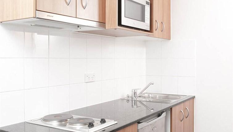 Compact kitchen at Mantra Parramatta