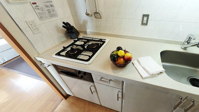 Simple kitchen in Oakwood Apartments Roppongi Central Tokyo