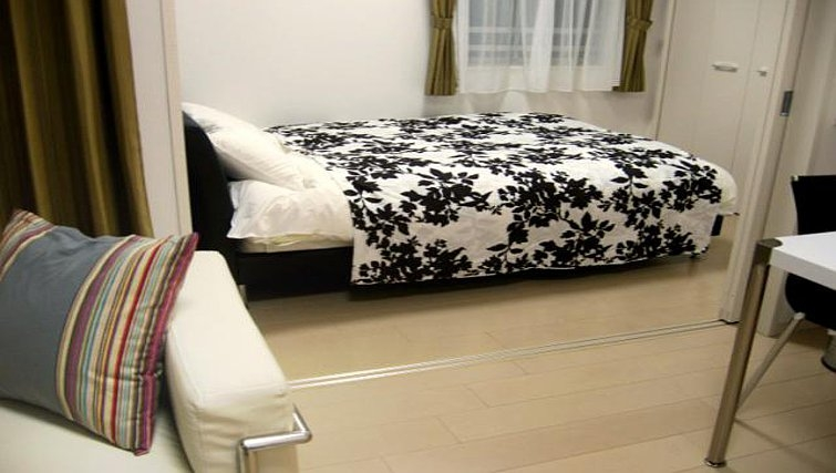 Comfortable bedroom at Central Crib Roppongi II Apartments