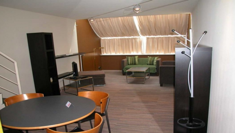 Modern living area in Route d Arlon Apartments