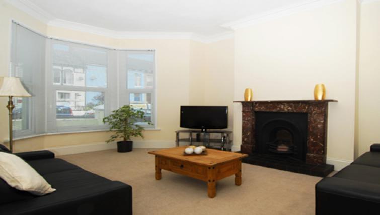 Spacious living area in Belgrace Apartment