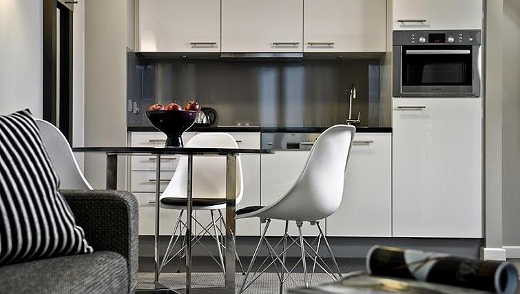 Compact kitchen at Adina Apartment Hotel Frankfurt Neue Oper