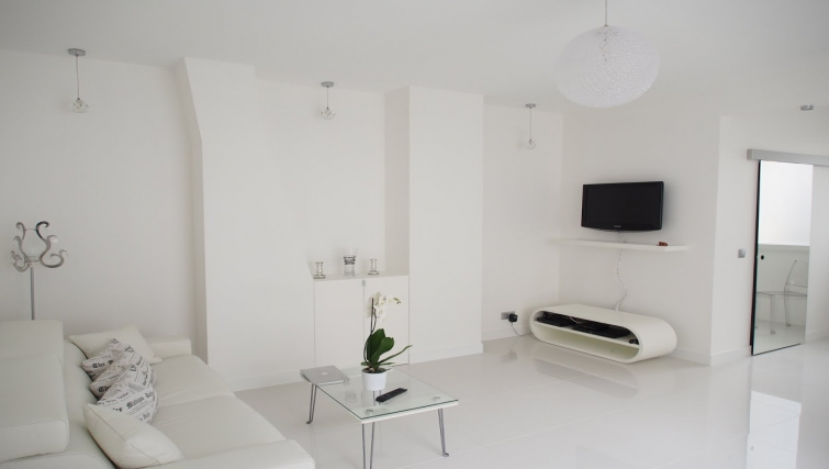 Simple living area in Avenue Montaigne Apartments