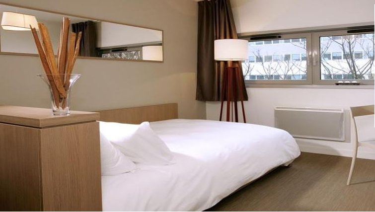 Comfortable bedroom in Appart City Versailles Saint Cyr L'Ecole