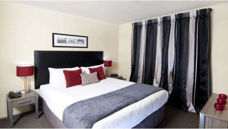 Attractive bedroom at Quest Auckland