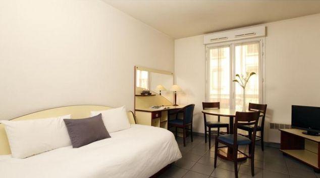 Tasteful living area in Appart City Lyon Villeurbanne