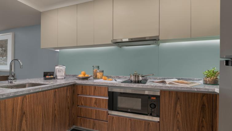 Equipped kitchen at Ascott Makati Apartments