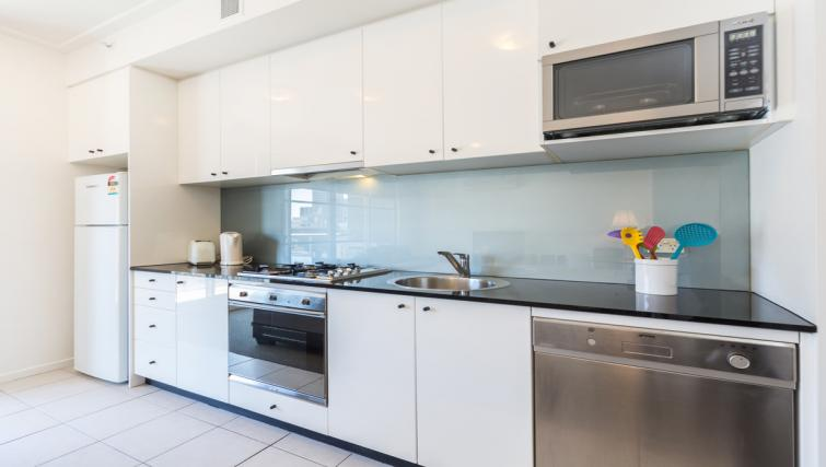 Equipped kitchen at Astra Apartments Sydney CBD Rex