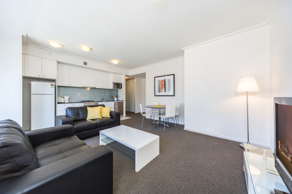 Living area at Astra Apartments Sydney CBD Rex