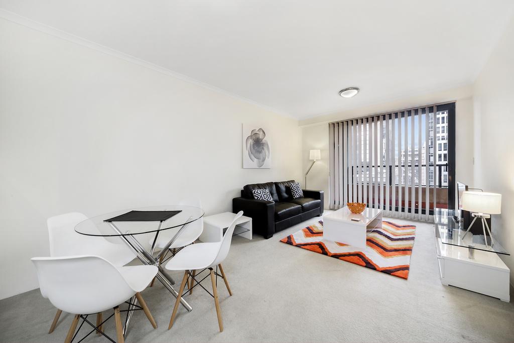Open-plan living area at Astra Apartments Sydney CBD Aston