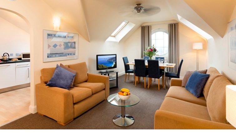 Tasteful living area in SACO Jersey - Merlin House