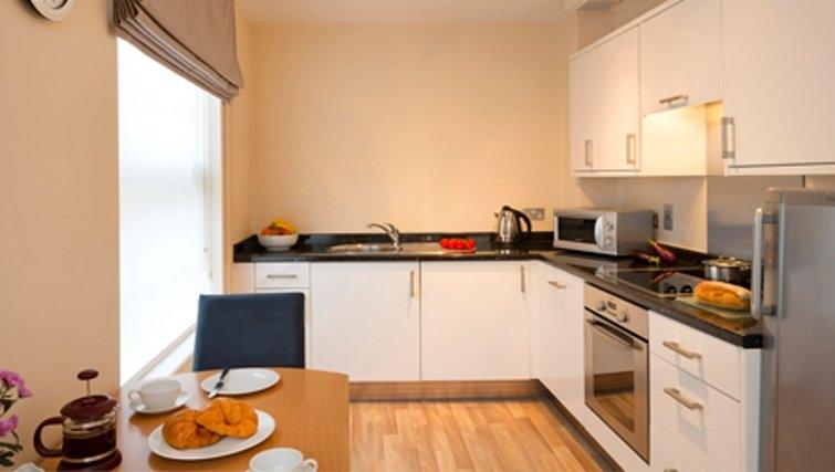 Modern kitchen in SACO Jersey - Merlin House