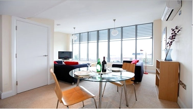 Modern dining area in Mandara Point Apartments