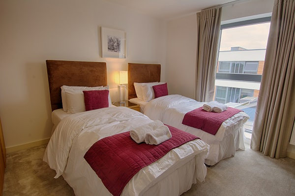 Twin beds at The Residence Apartments