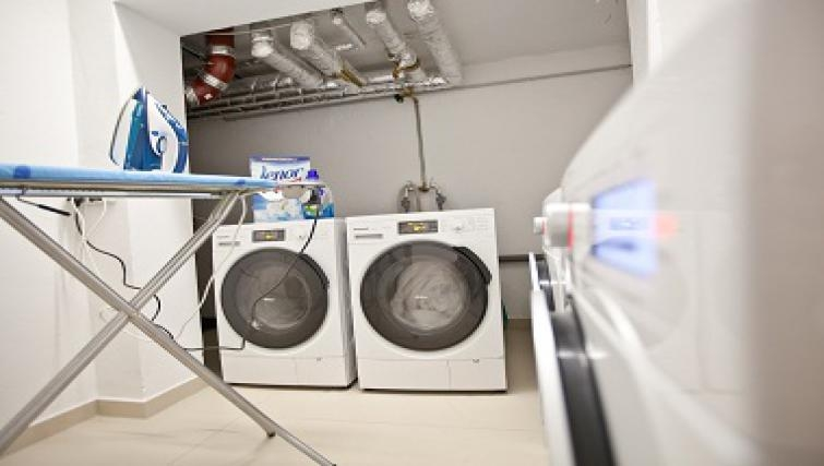 Practical communal laundry room in Goodmans Living Apartments